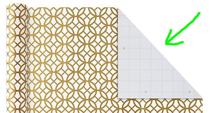 Wrapping paper with a corner folded back showing a 1 inch grid.