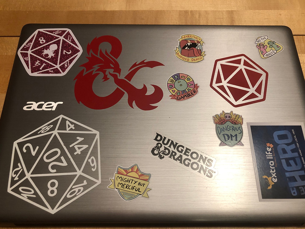 Computer covered with D&D stickers