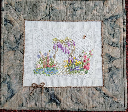 In The Garden Art Quilt  Hand embroidered, embellished, couched yarn, hand quilted. ByCarol Daniels