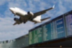 Airport flight schedule with list of flights and civil airliner on blue sky