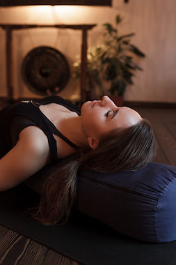 Woman resting after a yoga class in shav