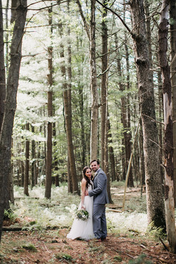 woods couple looking at camera