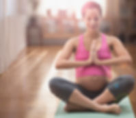 Pregnant mixed race woman meditating on