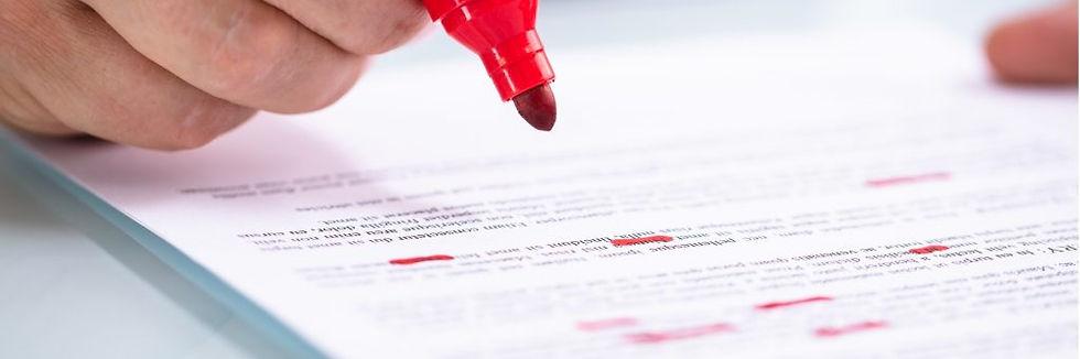 businessperson-holding-marker-on-documen