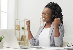 black-lady-celebrating-business-success-