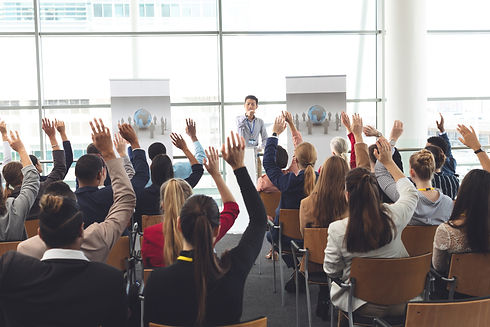 business-professionals-raising-hands-in-