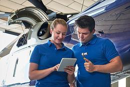 aero-engineer-and-apprentice-working-on-