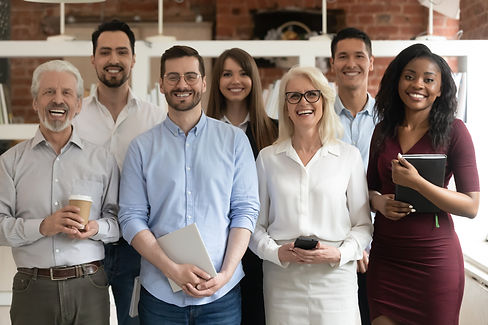 happy-diverse-business-team-standing-in-