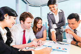 asian-business-team-discussing-report-38
