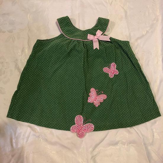 Green corduroy dress with butterflies.