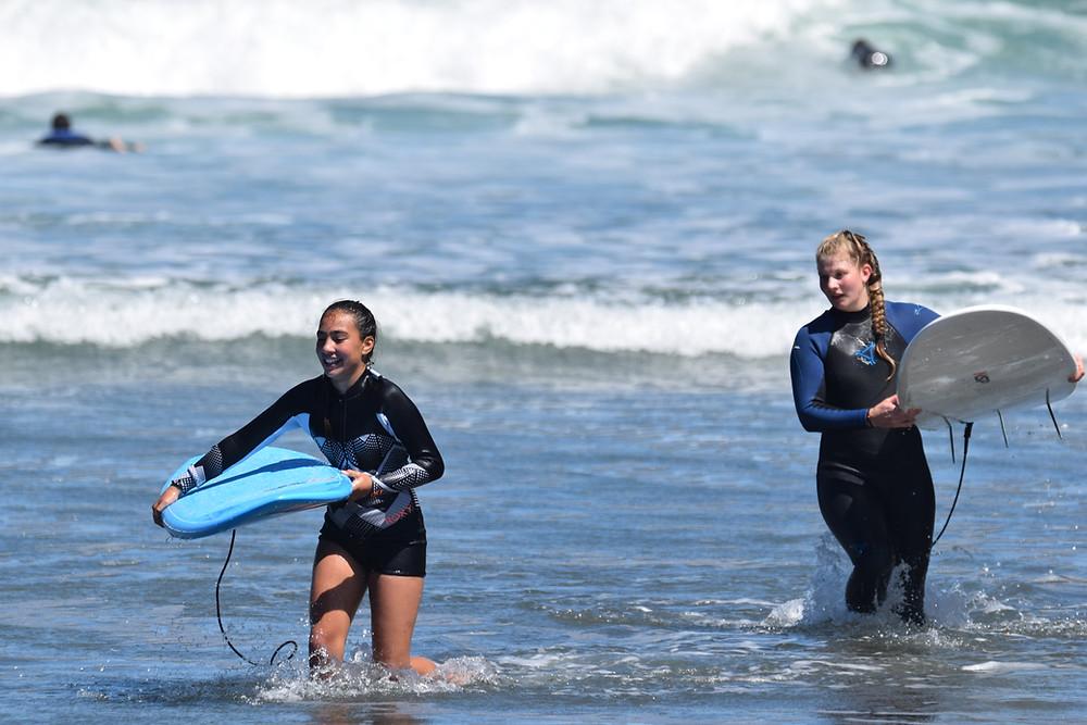 Girls Learning to Surf, Black Sand Beach, Piha