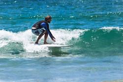 Surfer Piha Beach