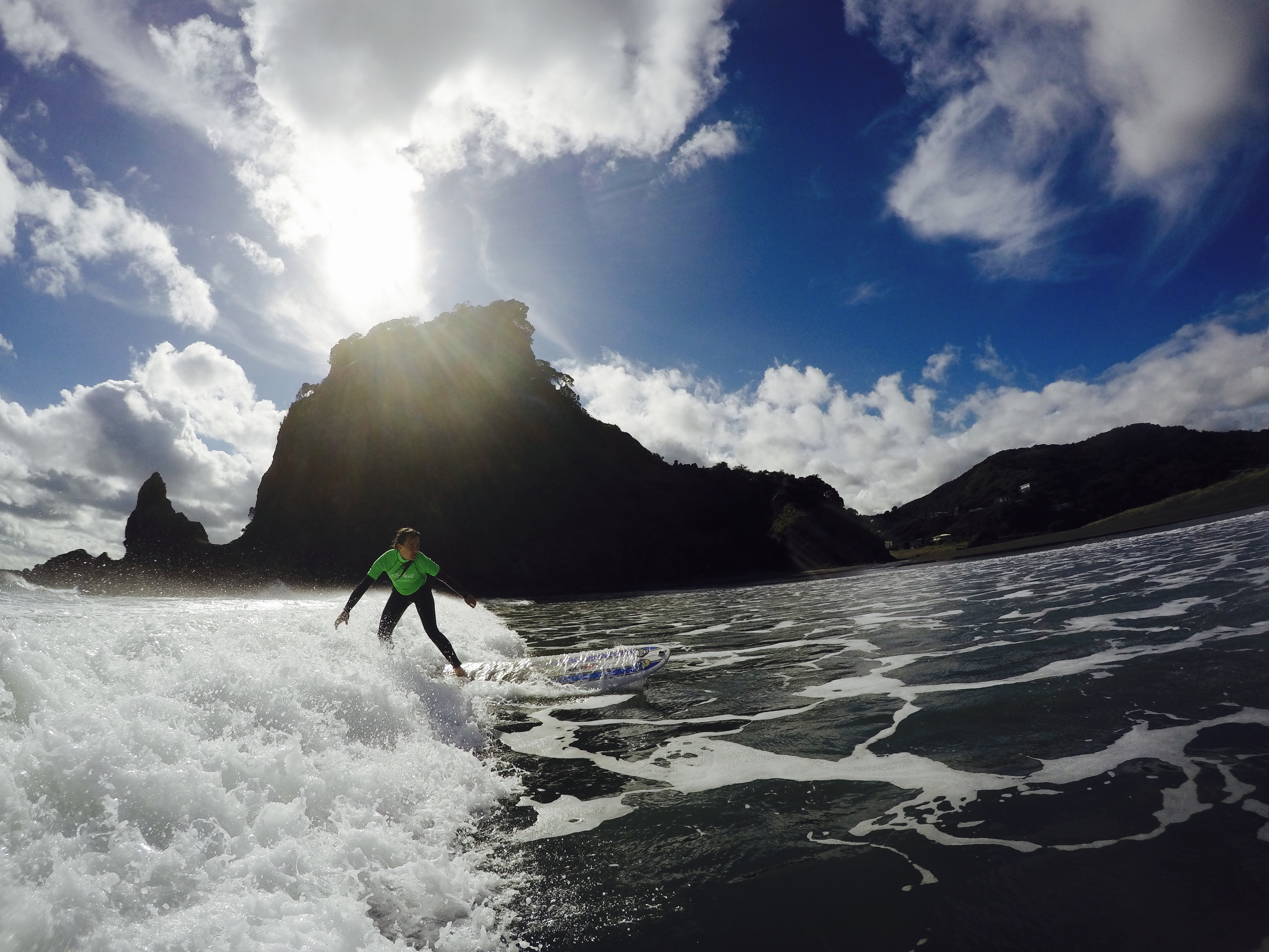 Surfing at Piha Beach