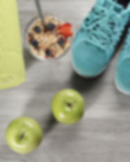 yoga mat with sport shoes and healthy fo