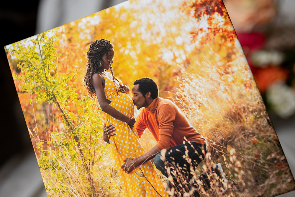 Father kissing mom's pregnant belly - maternity photo printed on canvas