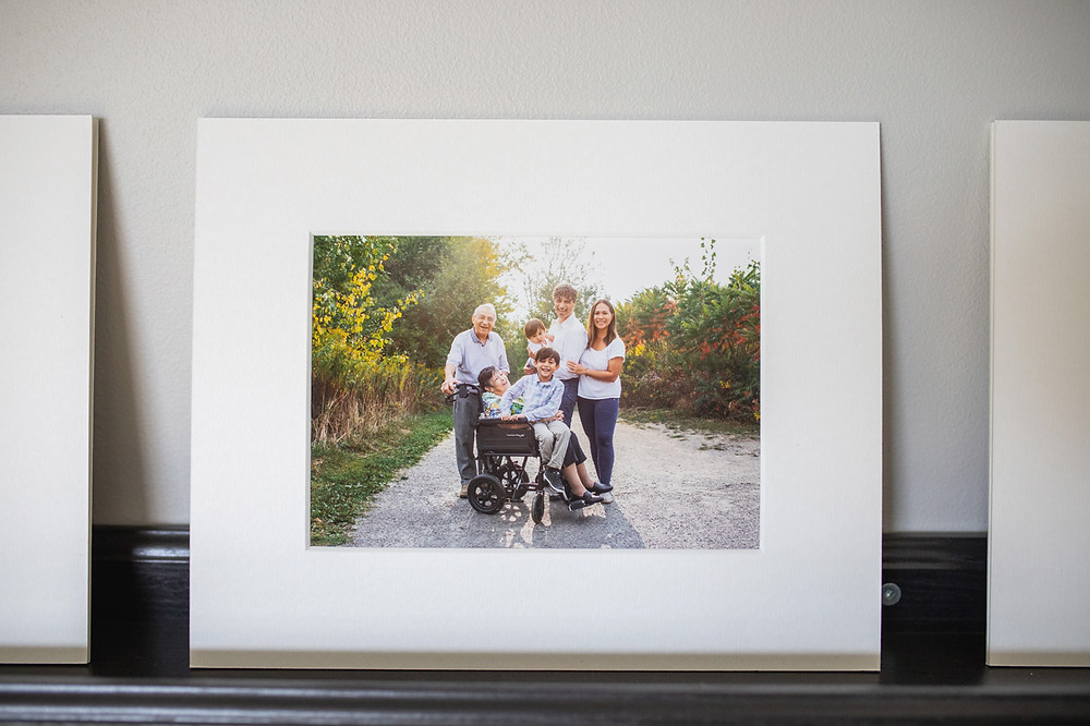 Professional photo of a happy family in a Toronto park with grandparents and children