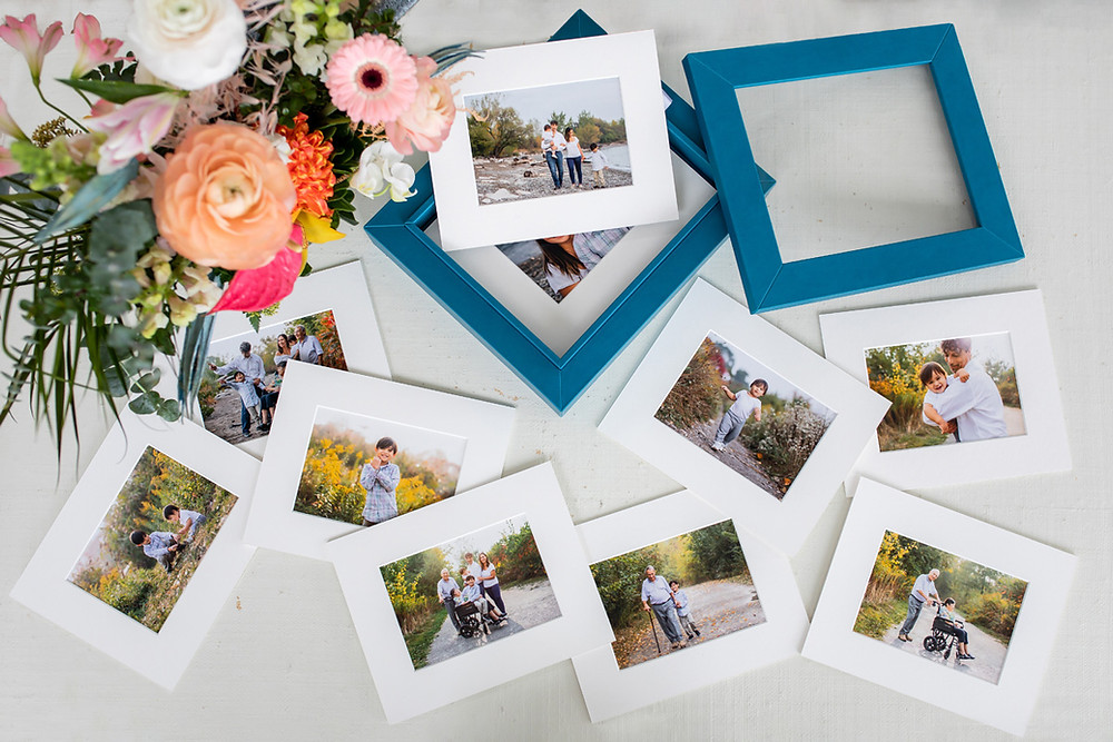 Beautiful printed family photos scattered on the table