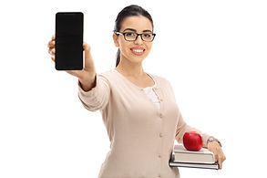 Female teacher showing a phone and smili