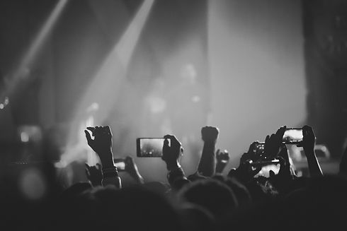 audience-members-hold-up-mobile-phones-f