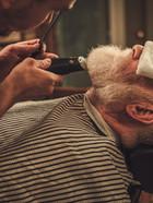 Confident senior man visiting hairstylis