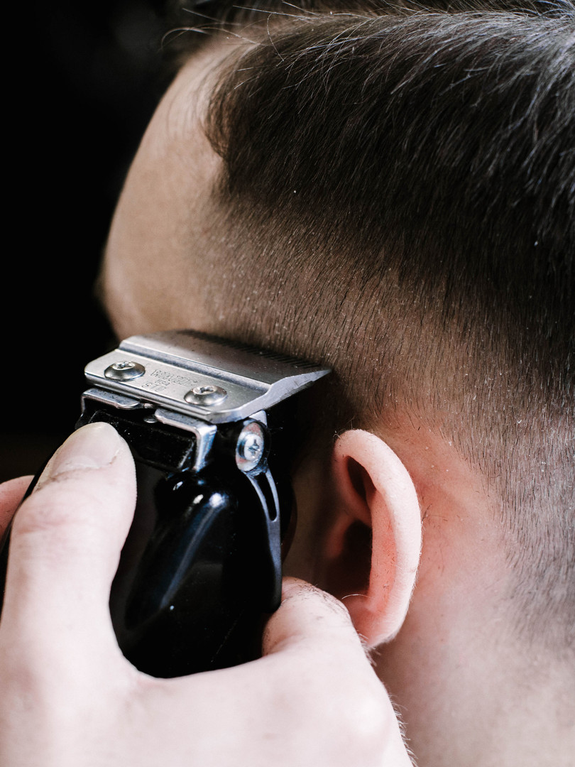 Barber cleans man's hair remained undern