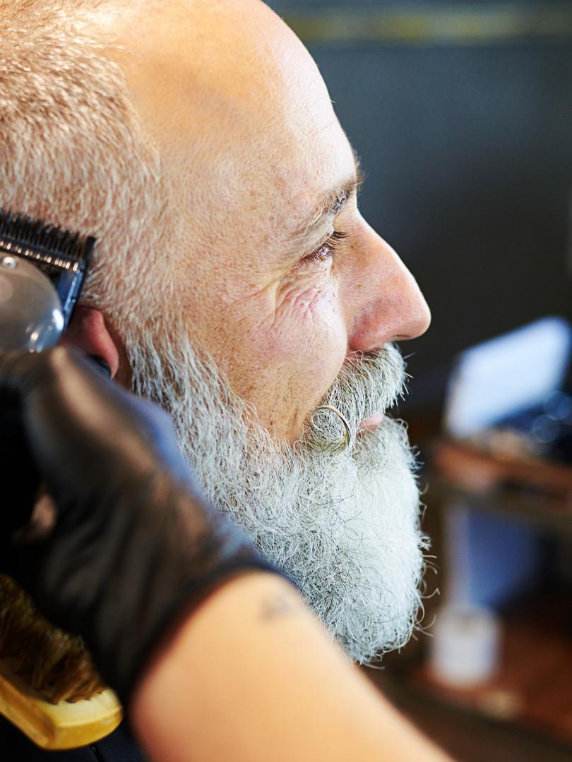 sideview portrait of senior bearded man