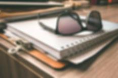 black-frame-wayfarer-sunglasses-on-white