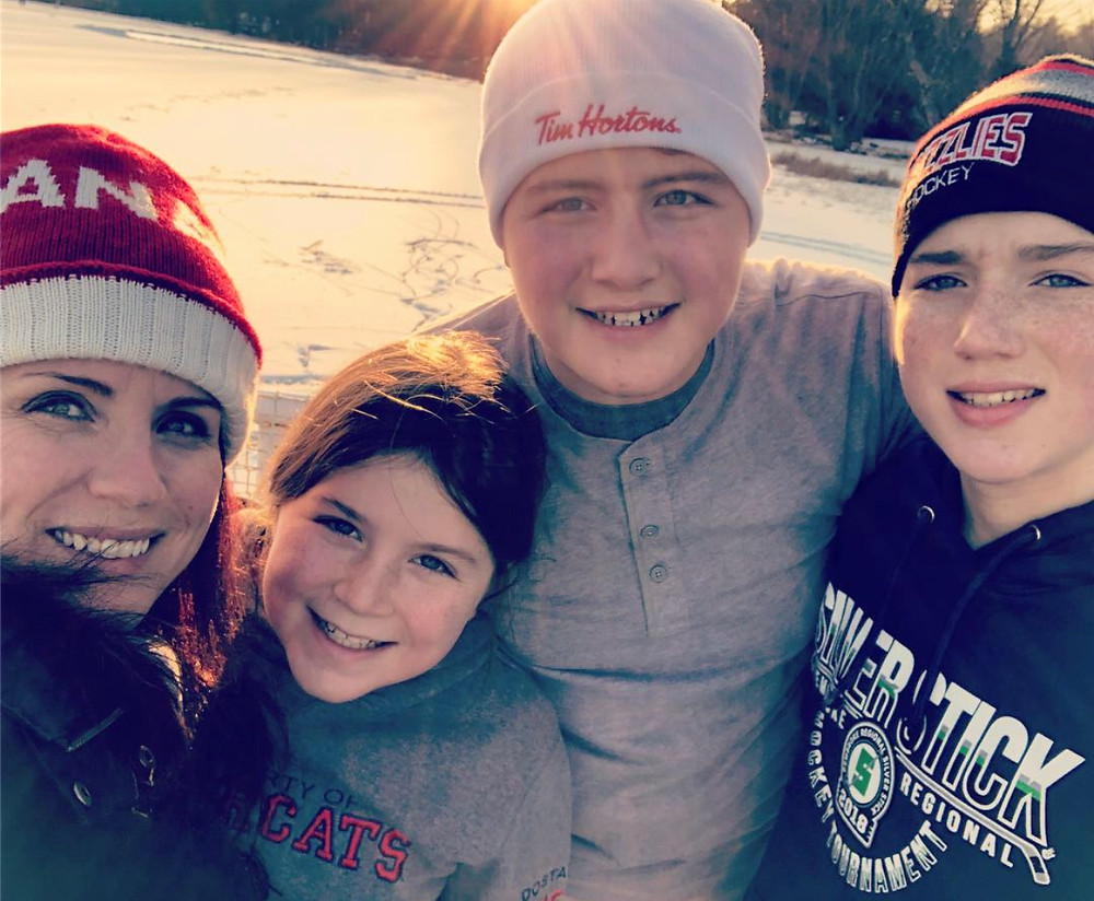 Theresa Bailey with her children skating on Moira Lake 2019