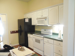 kitchen with stove microwave and fridge.JPG