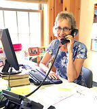 Answering the phone at Singing Hills Camp NH