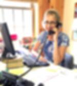 Answering th phone at Singing Hills Camp NH