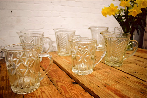 Vintage Glass Jugs side view with flowers