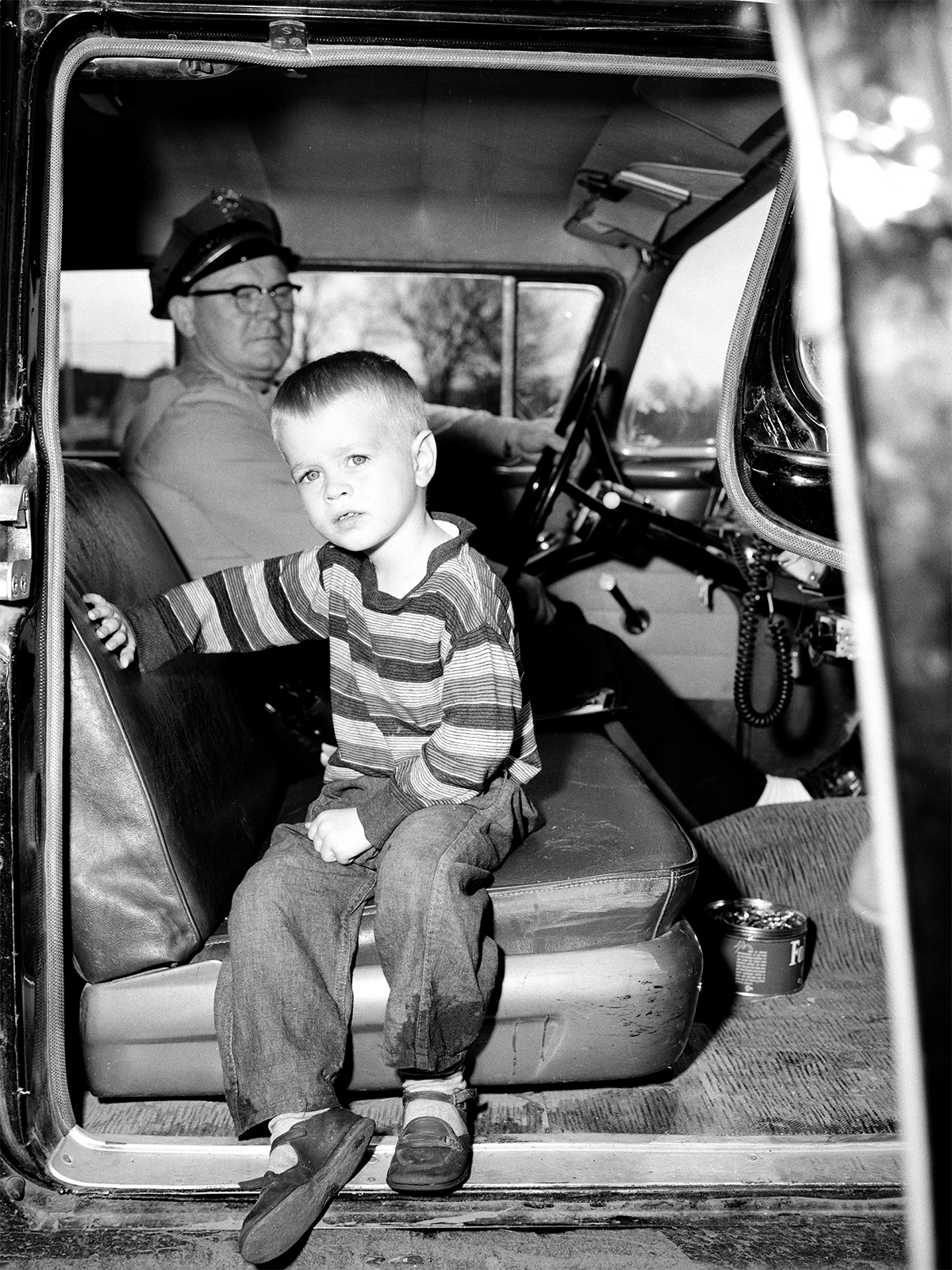 Lost boy in police car