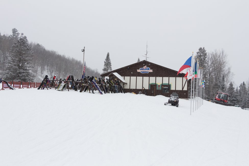 snowmobilers and skiiers in cabin wisconsin
