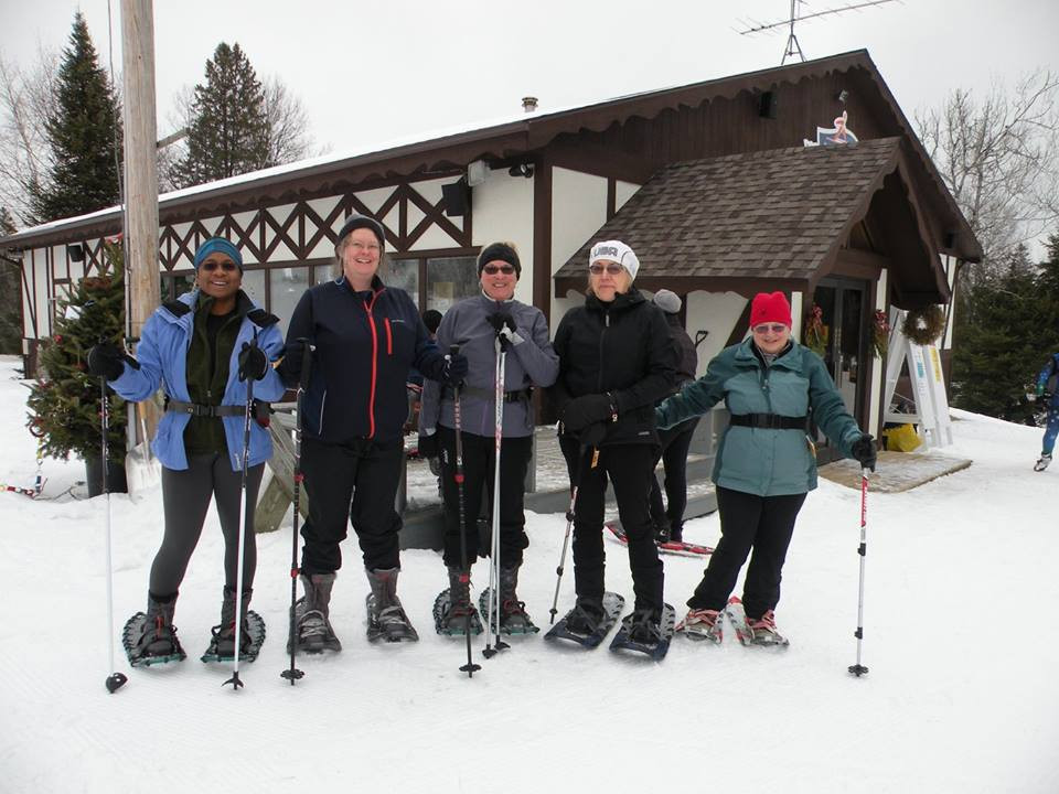 people in front of cabin at winter park