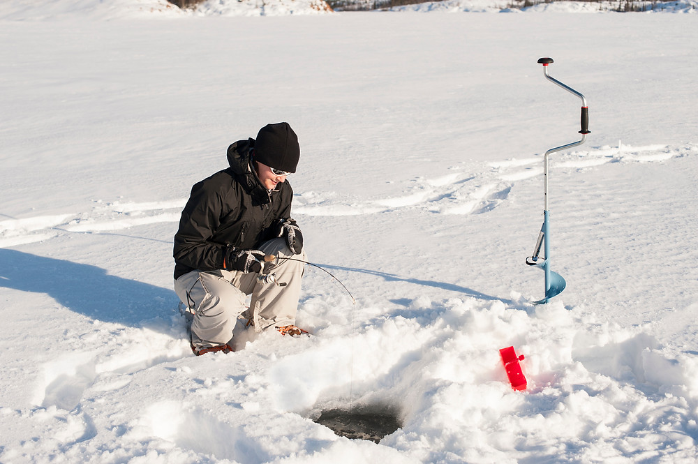 kid ice fishing in northwoods