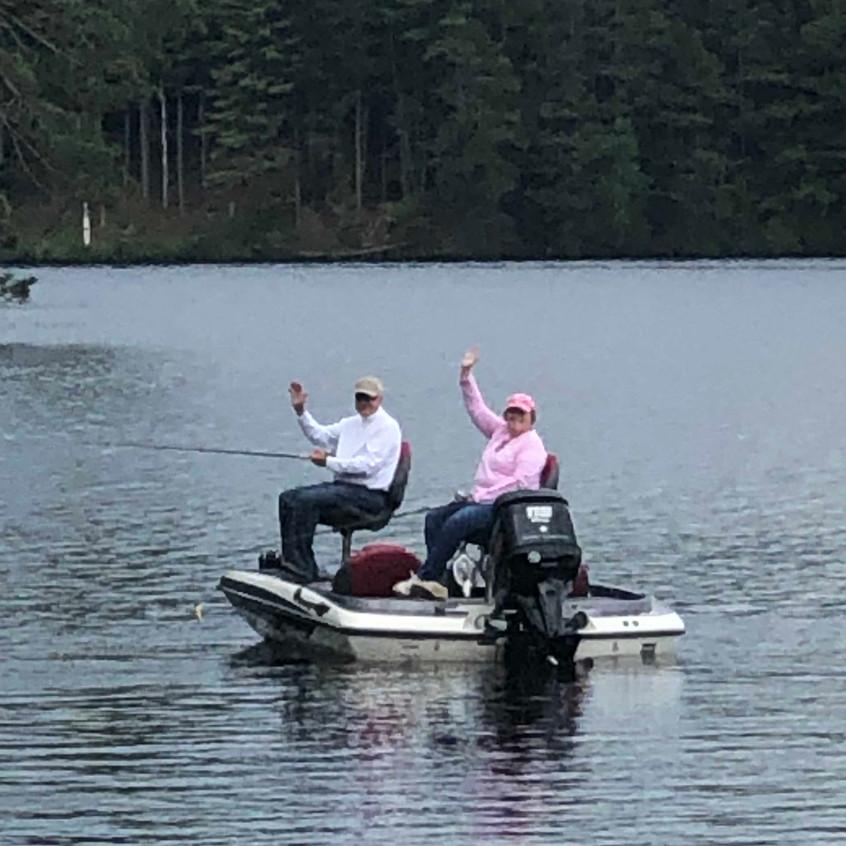 happy couple on boat on lake