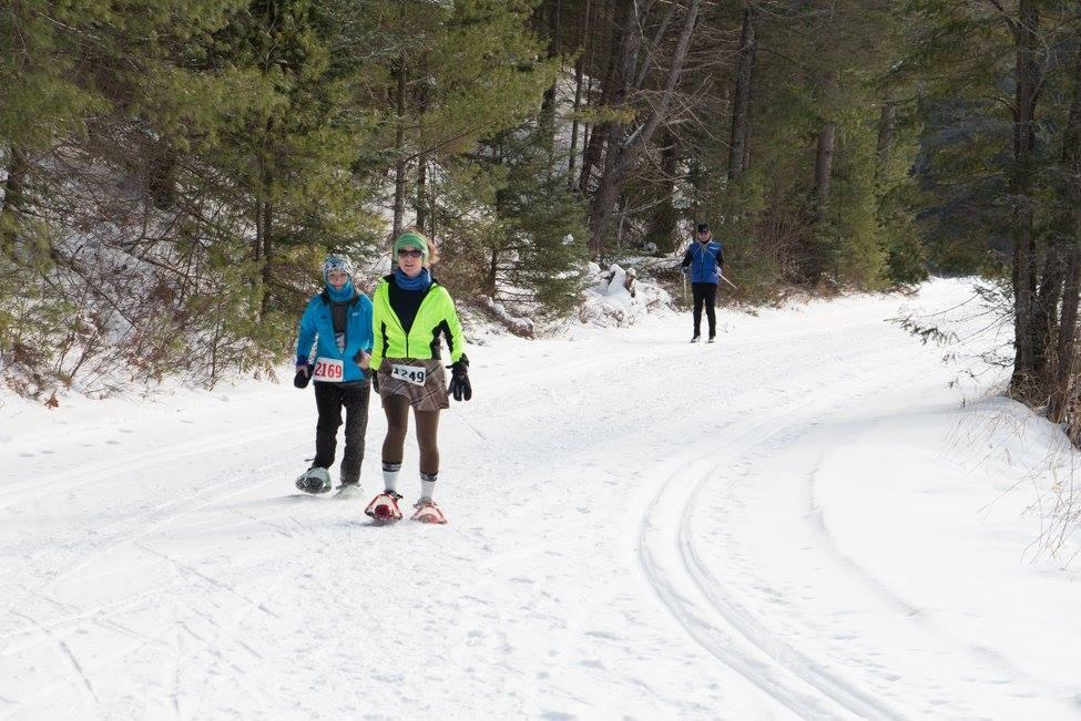 people snowshoeing at minocqua winter resort