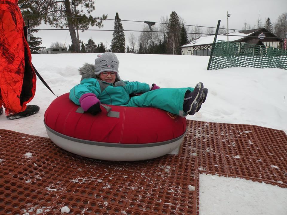 child on inner tube wisconsin ski resort