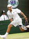Andy Roddick return serve between legs  8x10 11x14 16x20 photo 662