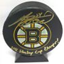 Adam McQuaid signed Boston Bruins hockey puck w/ Stanley Cup Champs inscription