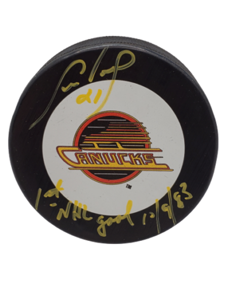 """Cam Neely Vancouver Canucks signed puck inscribed """"1st NHL Goal 12/9/83"""""""