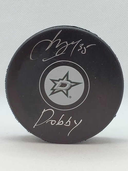 Anton Khudobin Dallas Stars signed Stars LOGO puck inscribed Dobby