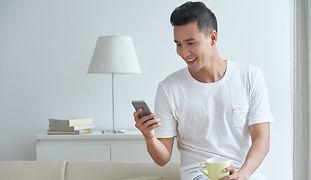 medium-shot-young-gut-busy-texting-messa