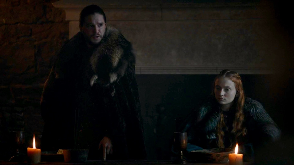 Kit Harington as Jon Snow and Sophie Turner as Sansa Stark on Game of Thrones. Costume Design by April Ferry.