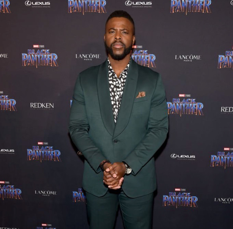 Winston Duke wearing a Dolce & Gabbana shirt with suit from The Black Tux. Styled by Jenny Ricker.