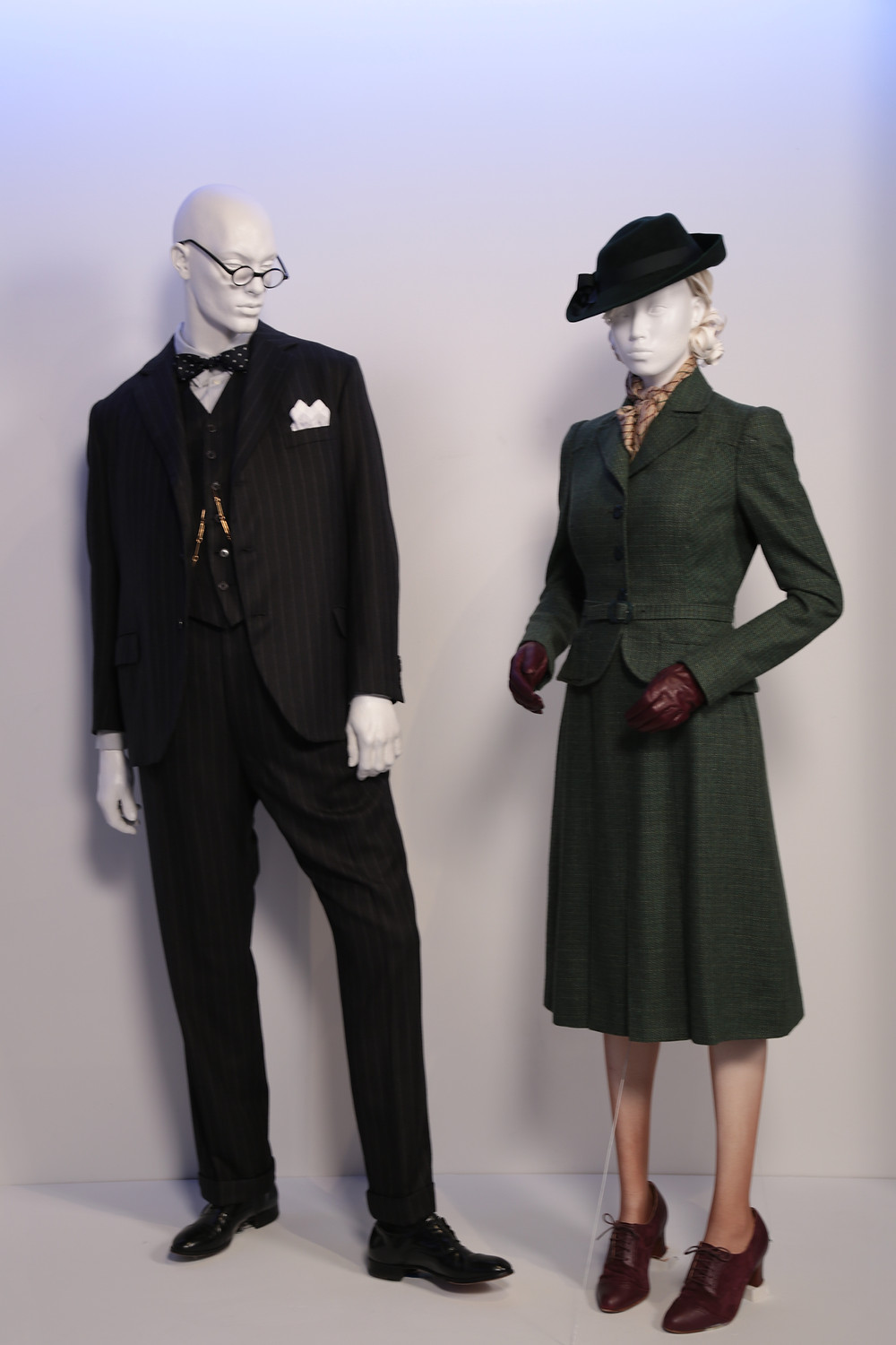 """Darkest Hour"" costumes by Jacqueline Durran, Academy Award nominee for Costume Design. (L to R) Costumes worn by actors: Gary Oldman as Winston Churchill, Lily James as Elizabeth Layton."
