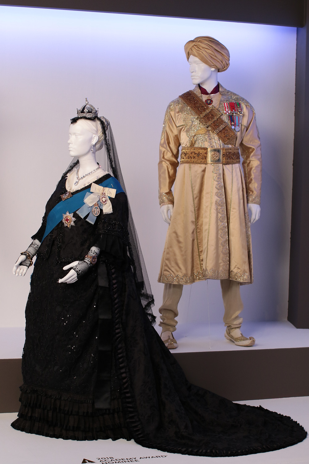 """Victoria & Abdul"" costumes by Consolata Boyle, Academy Award nominee for Costume Design. (L to R) Costumes worn by actors: Ali Fazal as Abdul Karim, Judi Dench as Queen Victoria."
