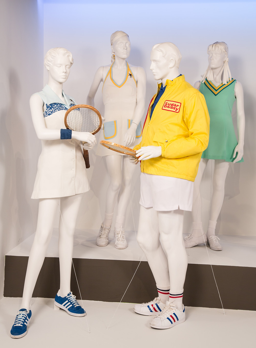 """Battle of the Sexes"" costumes by Mary Zophres. (L to R) Costumes worn by actors: Emma Stone as Billie Jean King, Lauren Kline as Nancy Richey, Steve Carrell as Bobby Riggs, Martha MacIssac as Jane 'Peaches' Bartkowicz."