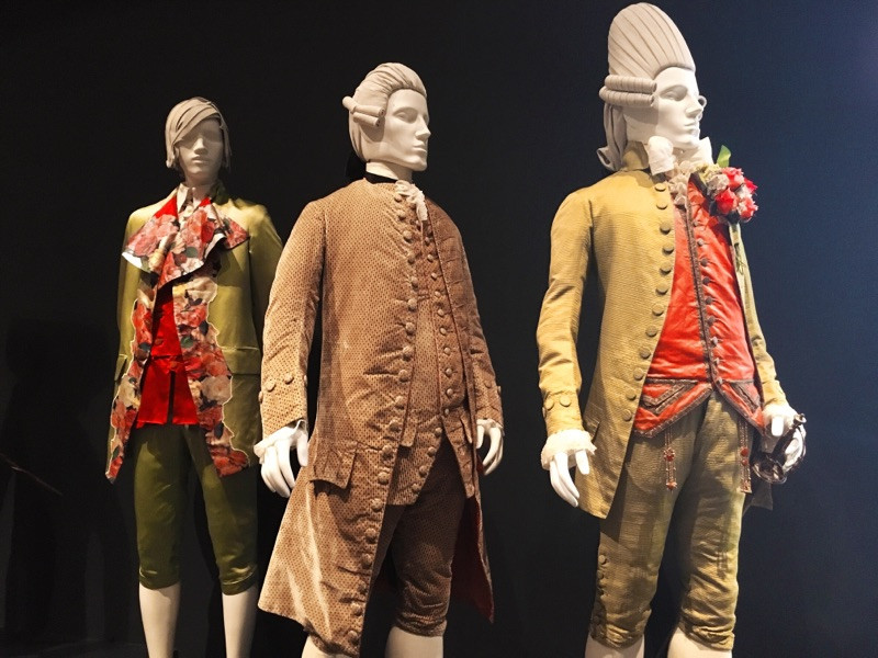 Vivienne Westwood Spring/Summer 1991 menswear ensemble (far left) influenced by 18th century macaroni attire.